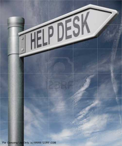 Directional Sign pointing to help desk