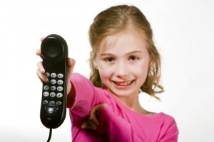 Child handing you the phone to start calling people