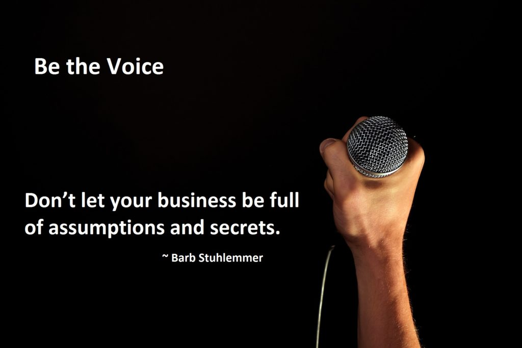 Hand holding a microphone - be the voice quote